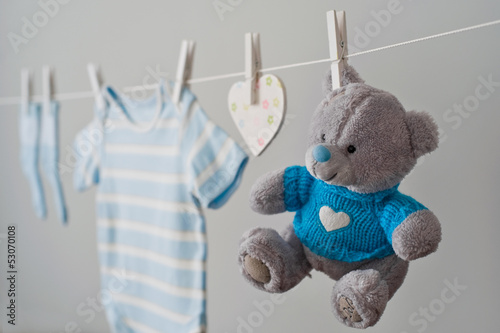 Fotografie, Obraz  blue baby clothes on the clothesline