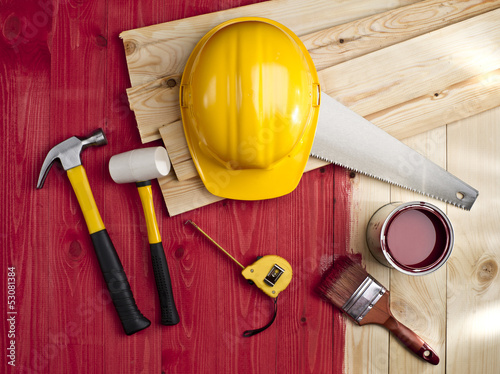 Fotografia, Obraz  red wood floor with a brush, paint, hammer and yellow helmet