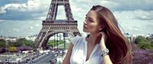 Beautiful Woman In Paris Near The Eiffel Tower