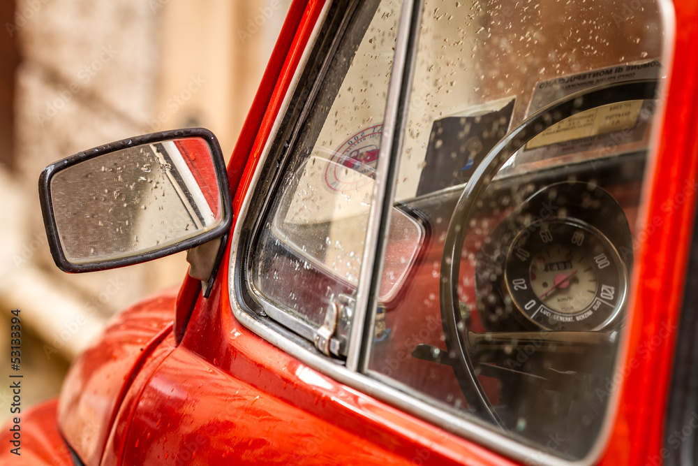 Fototapeta Vintage red car in Italy