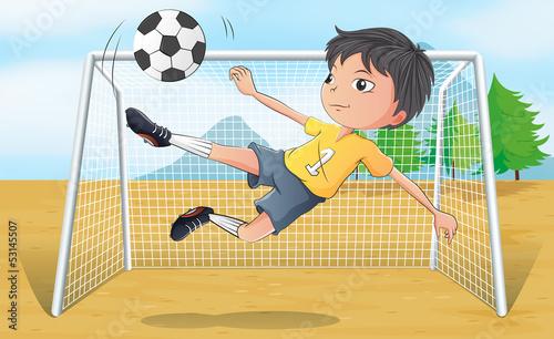 A soccer player kicking a soccer ball