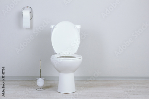 Fotomural  White toilet bowl in a bathroom