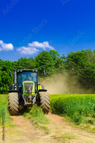 Photo  Tractor with baler