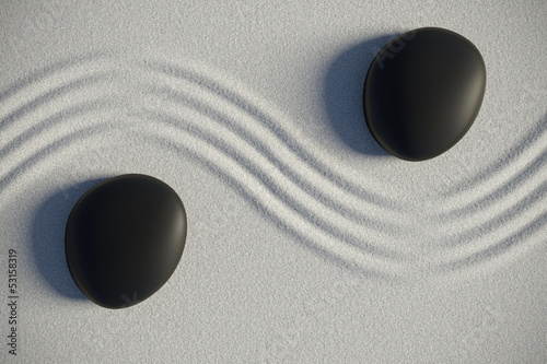 Zen garden in a top view with stones separated by a wave