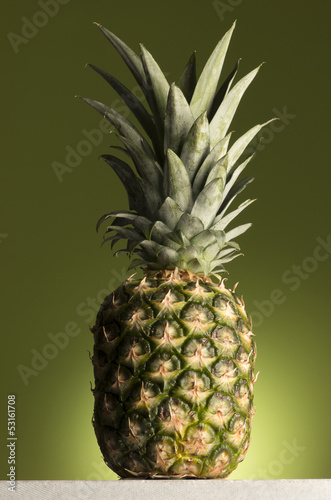 Fototapety, obrazy: pineapple on green background