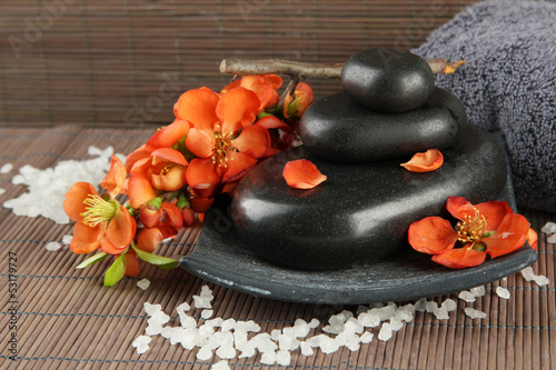 Poster Spa Spa stones and flowers on bamboo background