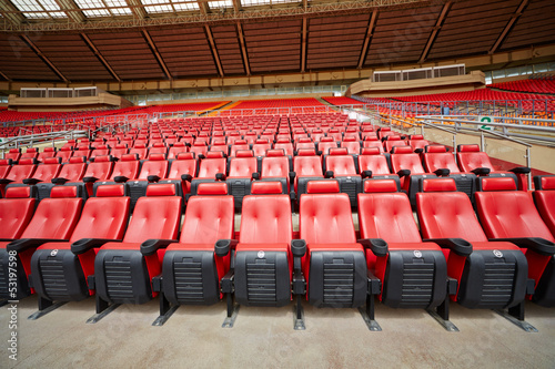 Rows of red armchairs at stadium