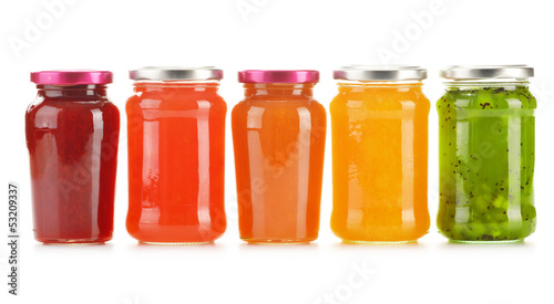 Jars of fruity jams isolated on white background Fototapeta