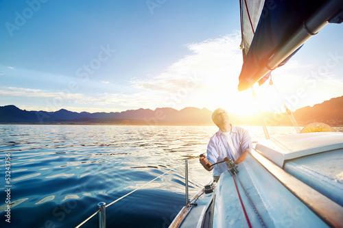 Fotografia  sunrise sailing boat