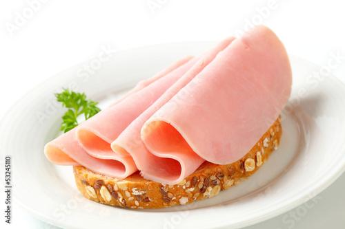 Fototapeta Bread with sliced ham obraz