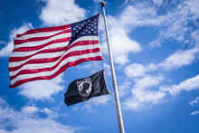 American And Pow Flags Waiving In Wind