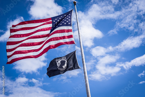 Photo  American and Pow flags waiving in wind