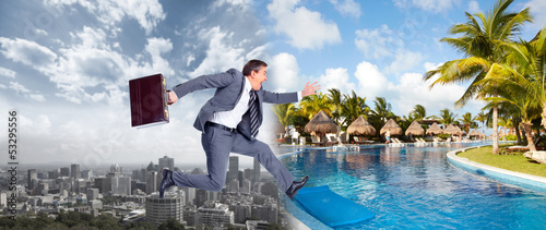 фотографія  Businessman jumping on the water.
