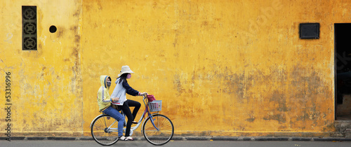 Canvas Print Two Girls on Bicycle