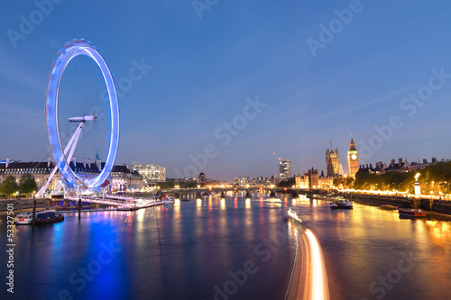 Foto op Canvas Londen London Eye And Big Ben On The Banks Of Thames River At Twilight