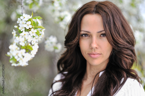 Fototapety, obrazy: Beautiful young woman face in blooming spring tree