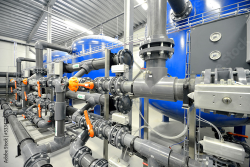 Tuinposter Industrial geb. new plastic pipes in industrial boiler room