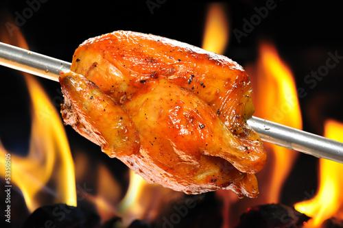 Obraz na płótnie roasted chicken on flame background
