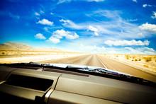 Dashboard Seen While Driving Hot Desert Road