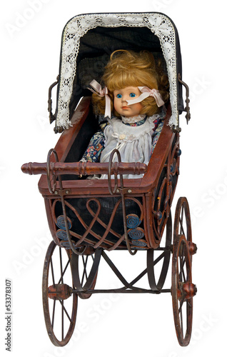 Fotografia  Vintage toy pram with doll. Clipping path included.
