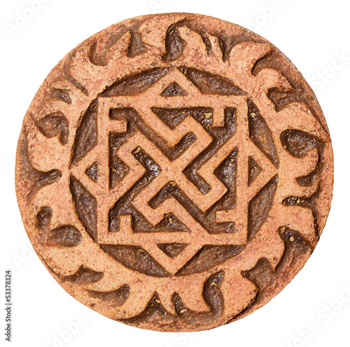 Old symbol on terracotta amulet Canvas Print