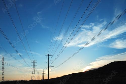 Valokuva  Power transmission towers at sunset