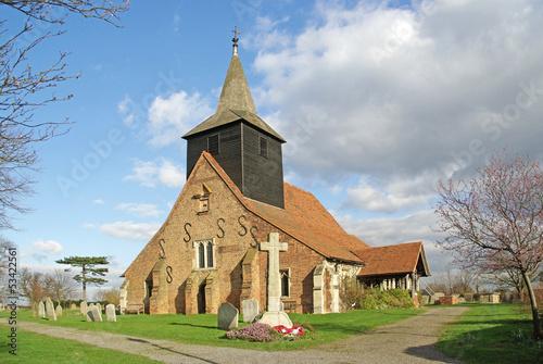 Parish Church and war memorial in rural setting Essex UK Poster