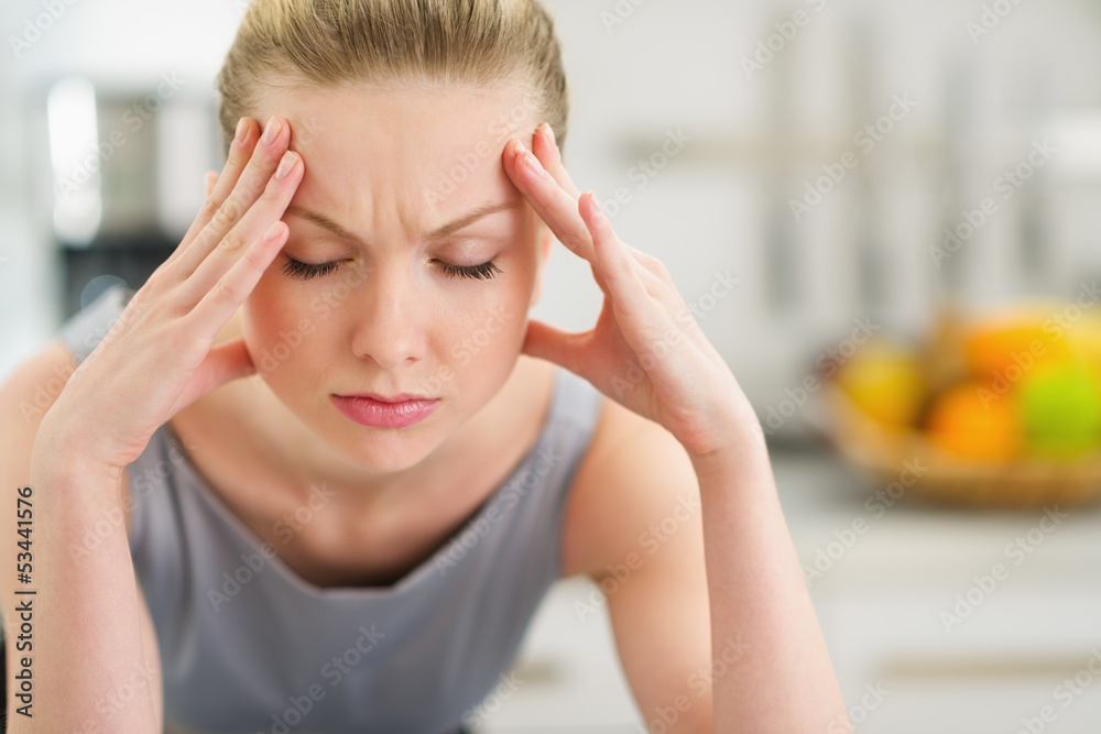 Fototapeta Portrait of stressed young housewife in modern kitchen