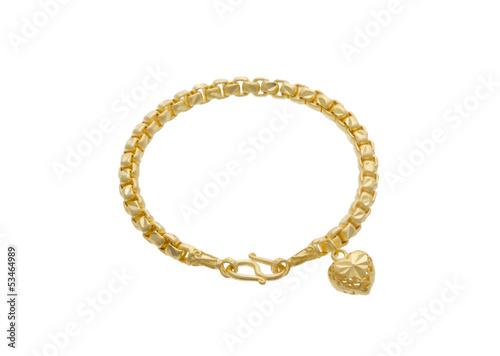 The attractive golden bracelet with a heart shape pendant Fototapete