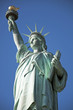 Statue of Liberty closeup blue sky background