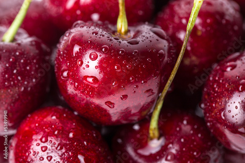 Fotografie, Obraz  Close-up of fresh cherry berries with water drops.
