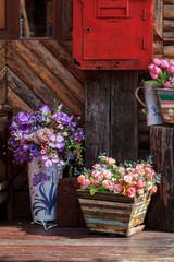 Fototapeta na wymiar different flowerpots as decoration of countryside house