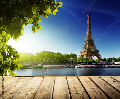 Poster Paris background with wooden deck table and Eiffel tower in Paris