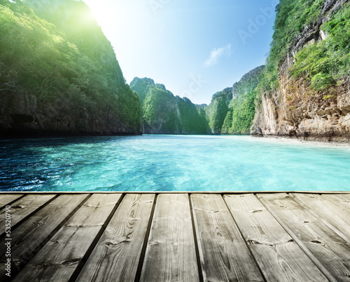 rock of Phi Phi island in Thailand and wooden platform #53520790
