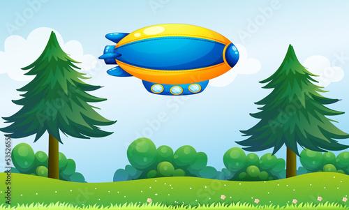 Papiers peints Avion, ballon An airship near the hilltop