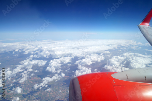 Fotografering  Flugzeug und Wolken