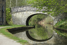 Stone Bridge Over Canal With D...