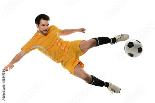 Photo  Soccer Player Kicking Ball