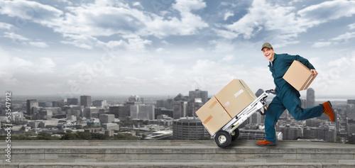 Fotografie, Obraz  Running Delivery postman.