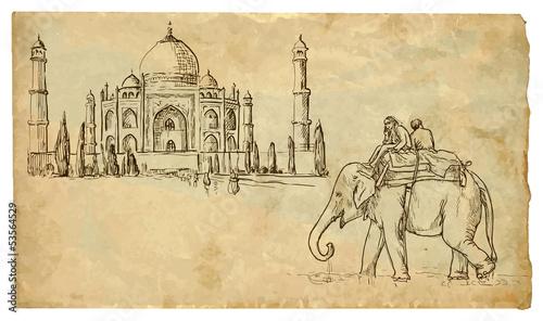 Fotografie, Obraz  Two people on an elephant outside the palace