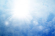 Sun on a blue sky with rays and flare, abstract background