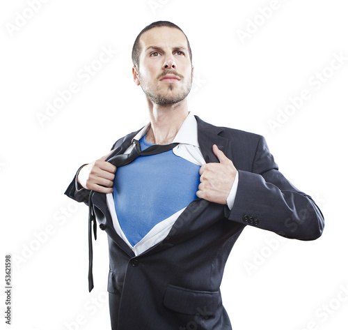 Fotografía  Young businessman acting like a super hero and tearing his shirt
