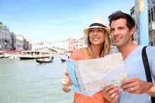Cheerful Tourists With City Ma...