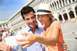 Couple in Venice taking picture of themselves with smartphone