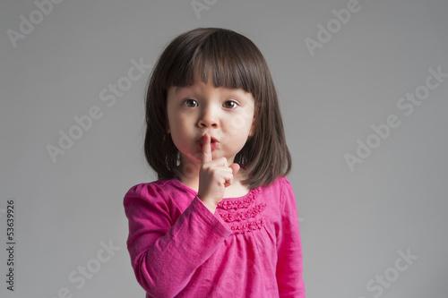 Fotografie, Obraz  Girl Making A Keep Quiet Gesture