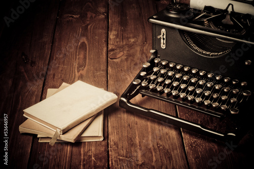 Vintage typewriter and old books, touch-up in retro style