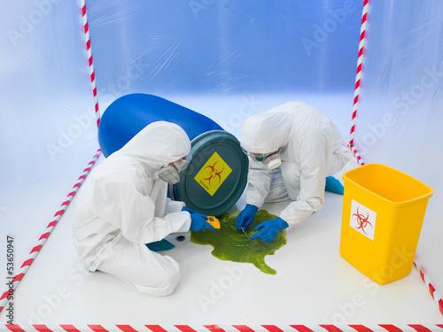 Fotografia  Attending to a biohazard chemical spill