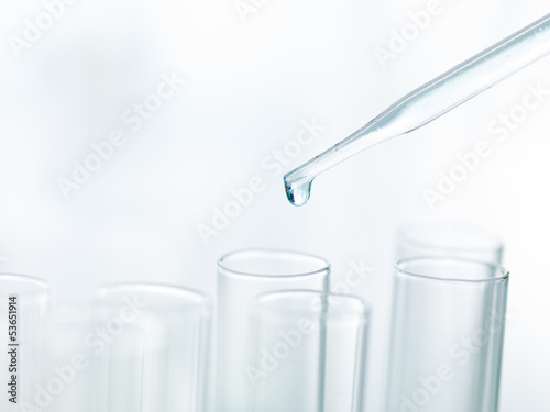 Pipette dripping in empty test tubes