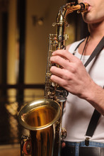 He Likes To Improvise On His Saxophone. Close-up Shot Of Men Hol