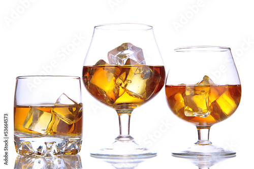 Foto op Canvas Alcohol Brandy glasses with ice isolated on white